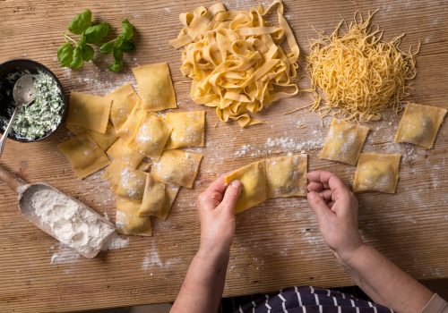 Woman making homemade pasta.